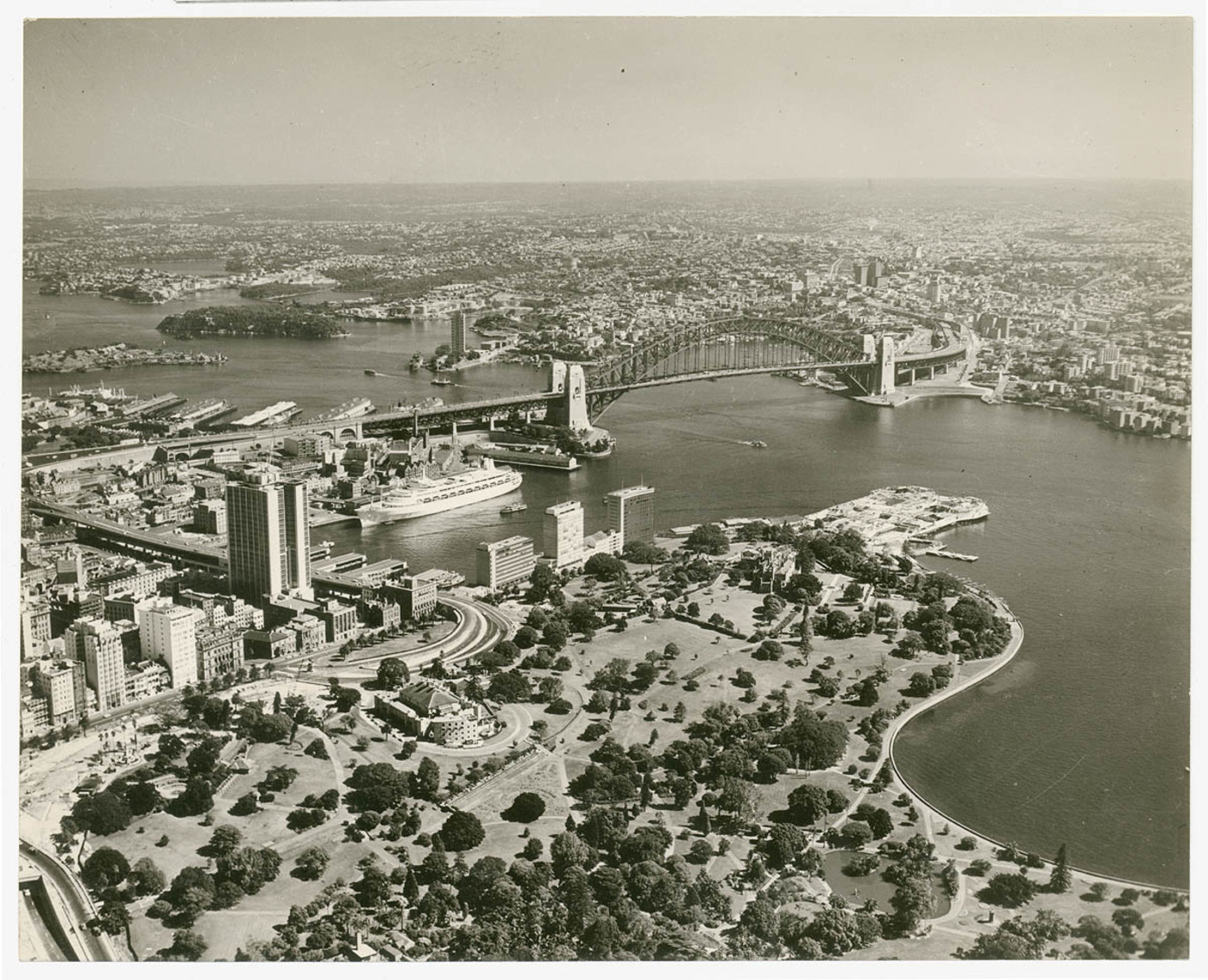 [AMP Building, Botanic Gardens, Harbour Bridge and Circular Quay with liner Canberra], July 1963, by Ern McQuillan