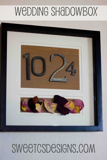 Make a shadowbox full of wedding mementos and your anniversary date- such a cute gift idea!