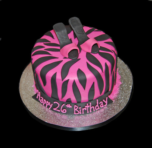 pink and black zebra birthday cake topped with high heel shoes