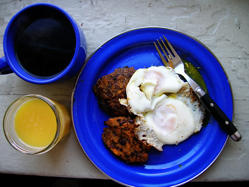 fried eggs and sweet potato bean cakes with OJ and coffee