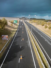 driving(0.0), road trip(0.0), asphalt(1.0), highway(1.0), road(1.0), lane(1.0), controlled-access highway(1.0), shoulder(1.0), road surface(1.0), infrastructure(1.0), tarmac(1.0),
