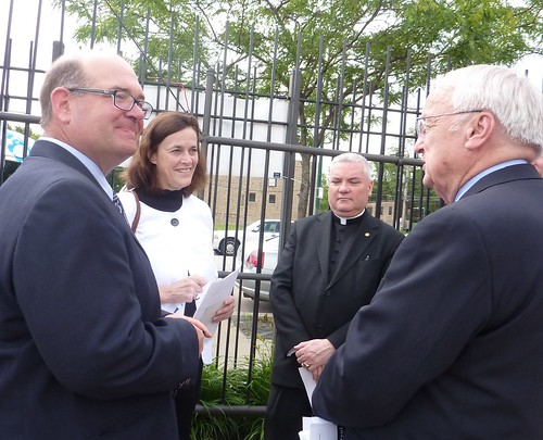 Under Secretary Concannon speaks with members of the Chicago Summer Food Work Group. From left: Mark Haller (ISBE), Diane Doherty (IHC), Monsignor Michael Boland (Archdiocese of Chicago), Under Secretary Kevin Concannon (USDA).