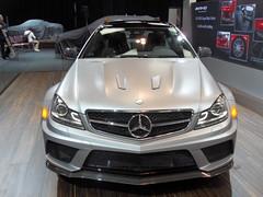mercedes-benz c-class(0.0), automobile(1.0), automotive exterior(1.0), mercedes-benz w212(1.0), wheel(1.0), vehicle(1.0), performance car(1.0), automotive design(1.0), mercedes-benz(1.0), rim(1.0), auto show(1.0), grille(1.0), bumper(1.0), land vehicle(1.0), luxury vehicle(1.0),