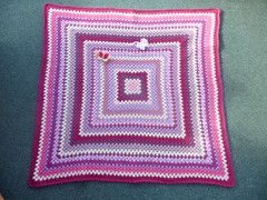 This is a gorgeous Granny Square Blanket using odd bits of 'unwanted yarn' in her stash! What a great way to use them up!