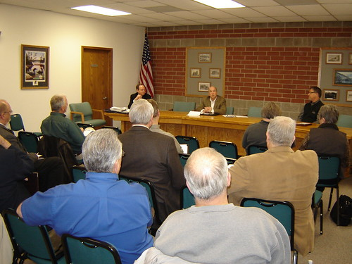 Iowa USDA Rural Development State Director Bill Menner (center, seated) and other federal officials, hold a roundtable meeting in Ogden, Iowa.