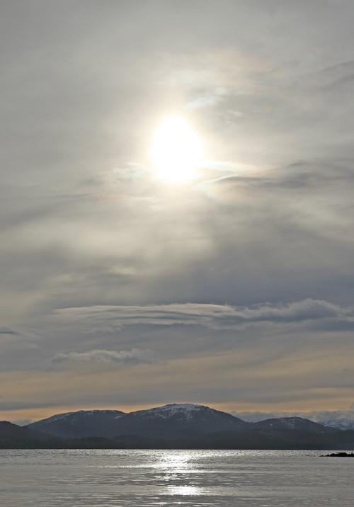 sun through clouds over Kasaan Bay, Kasaan, Alaska