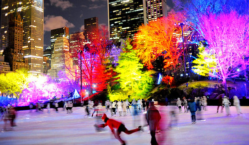 Colored lighting of trees, ice rink in Central Park