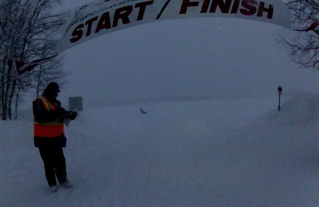 2012-jriditarod-aiyana-finish-snow