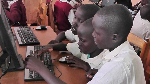 Class seven girls taking turns typing
