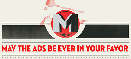 red and black mad men logo with text underneath that reads may the ads be ever in your favor