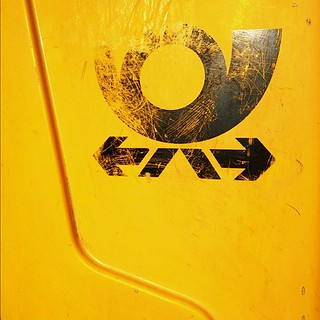 "scratchy logo of ""deutsche post"" on mailbox"
