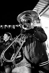 bassist(0.0), drummer(0.0), saxophone(0.0), guitarist(0.0), guitar(0.0), musician(1.0), tuba(1.0), trumpet(1.0), trombone(1.0), photograph(1.0), musical instrument(1.0), music(1.0), monochrome photography(1.0), jazz(1.0), monochrome(1.0), brass instrument(1.0), black-and-white(1.0), black(1.0),
