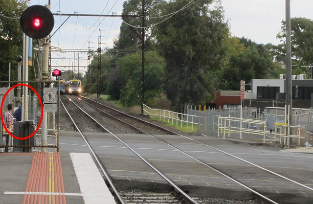 Cyclist risks death riding out in front of train (1/2)