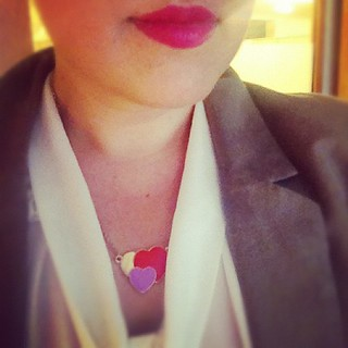 Pink lips and heart necklace.