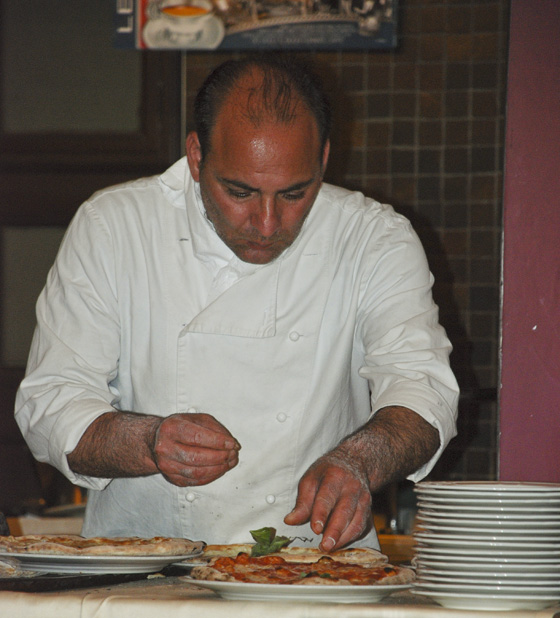 pizza maker in restaurant