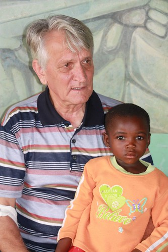 "In Mambasa: Père Sylvano with one of his many ""adopted"" children"