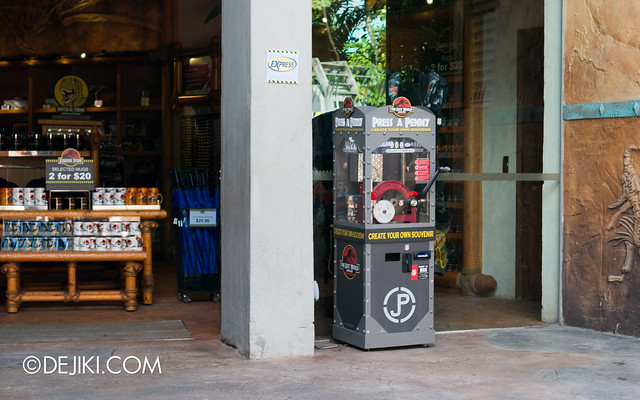 Press A Penny / Coin Souvenir - Jurassic Park machine