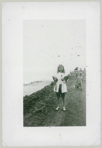 Girl holding box camera
