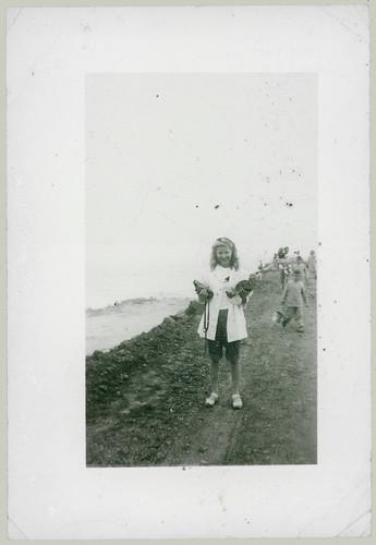 Girl holding box camera