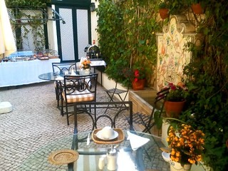 Breakfast buffet in garden at Janelas Verdes Lisbon