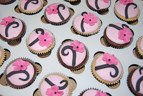pink and black flower birthday cupcakes