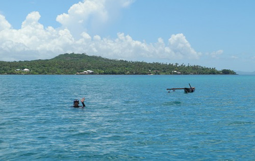 A local fisherman wishing us farewell on our return to Upolu.