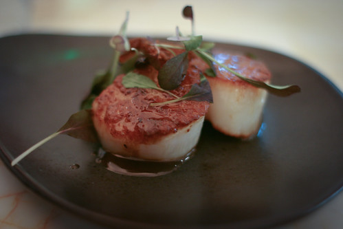 Seared scallops, pig's ears, black bean and ginger sauce