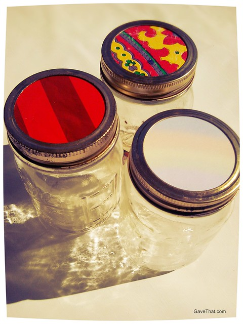 Adding bits of gift wrap on top of canning jar lids how to recycle wrapping paper ideas