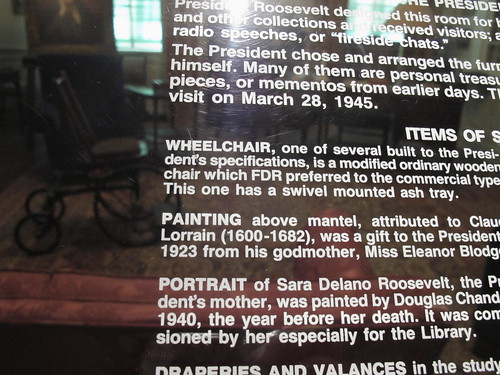 wheelchair with swivel mounted ashtray