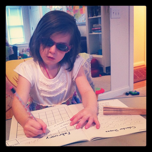 Apparently her future is so bright today, she has to wear shades while doing math.