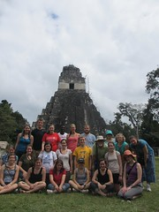 The group poses in front of Jaguar Temple on the main plaza in Tikal