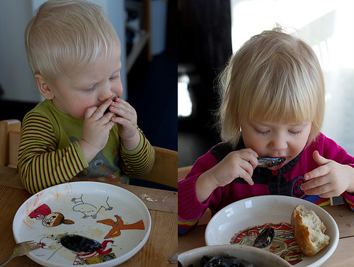 Kids eating mussels