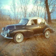 automobile, vehicle, morris minor, sedan, classic car, vintage car, land vehicle, luxury vehicle,