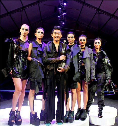 Renan Pacson with his trophy and models