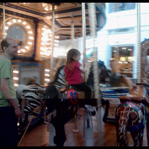 Birthday carousel ride!  Three year olds are so easy to please!