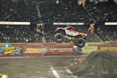 freestyle motocross(0.0), stock car racing(0.0), race of champions(0.0), motorcycle racing(0.0), screenshot(0.0), auto racing(1.0), racing(1.0), sport venue(1.0), vehicle(1.0), sports(1.0), race(1.0), dirt track racing(1.0), motorsport(1.0), monster truck(1.0), stunt performer(1.0), race track(1.0),