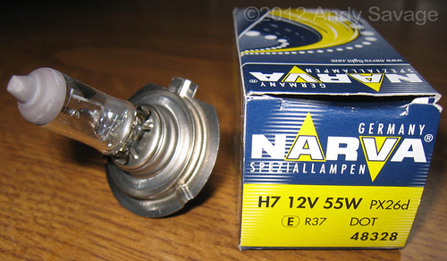 Faulty H7 Headlight bulb and new one in box.