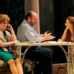 Eleanor (René Augesen) is deep in thought as her husband Max (Jack Willis) and her student Lenka (Delia MacDougall) make a connection in the Huntington Theatre Company's production of Tom Stoppard's <i>Rock 'n' Roll</i> at the Avenue of the Arts/BU Theatre. Part of the 2008-2009 season.