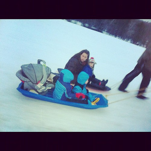 Taking a ride on the sled with the kiddos