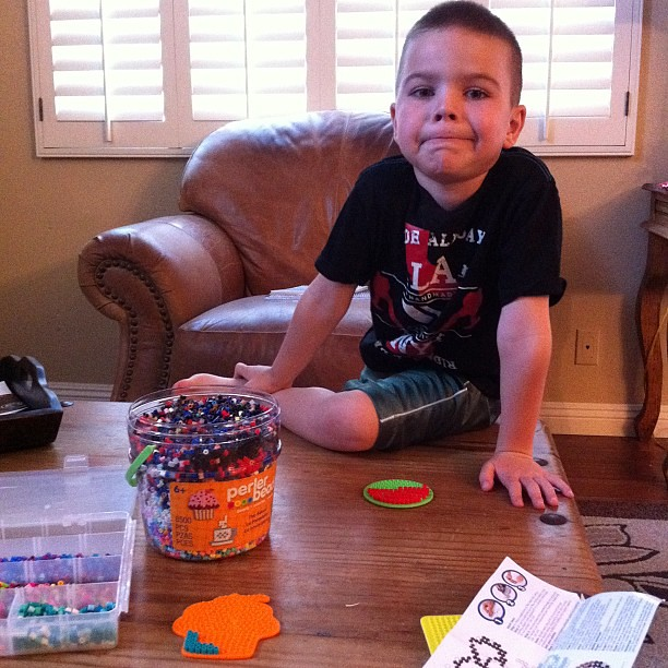 I caught the kid mid-craft. He is also making me do Perler Beads. I am doing a cupcake one.