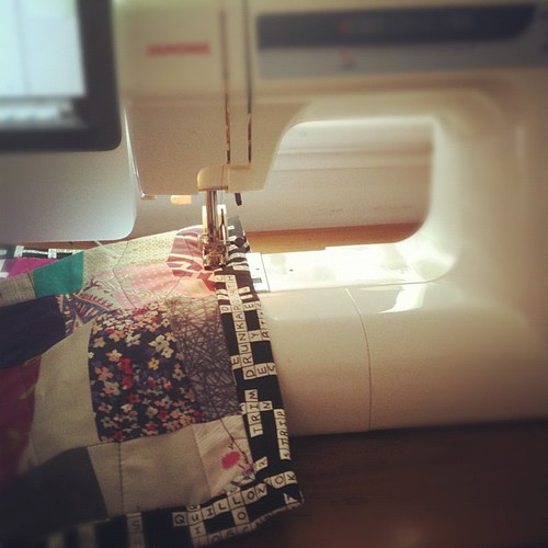 Feels good to be machine sewing binding on Rainbow Road by A Labour of Love