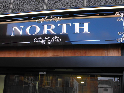 BESPOKE CARVED SIGN WITH SILVER LEAF AT NORTH CLOTHING
