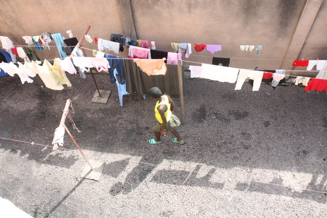 A girl walks in the courtyard of a project run by the NGO War Child that is supporting and protecting vulnerable girls living and working on the streets of Kinshasa, DRC.