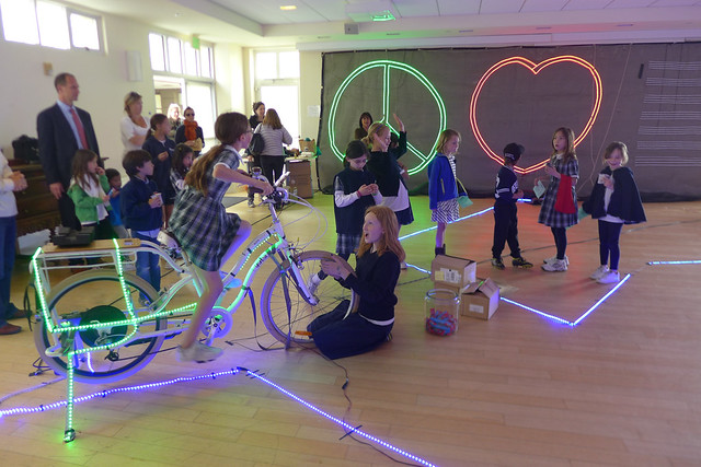 children pedal power lights at school presentation