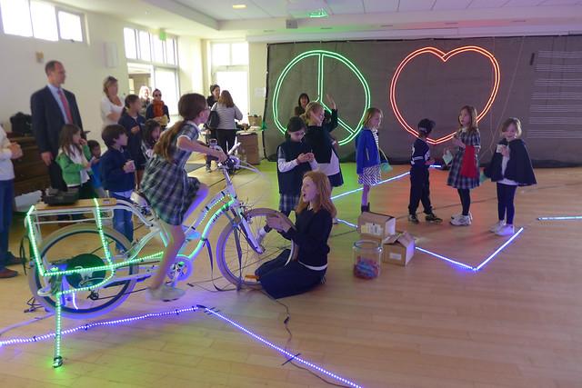children pedal power lights at school presentation