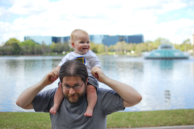 Hitching a ride on Daddy's shoulders.