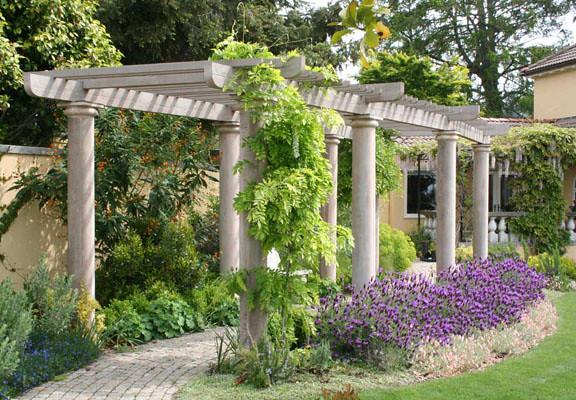 Wooden arbor colonnade is a garden highlight.
