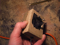 Wooden casing for mains plug