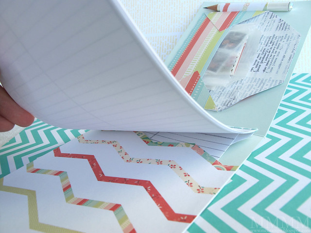 pocket in the back with chevron zig zag edge (to slide notepad into)