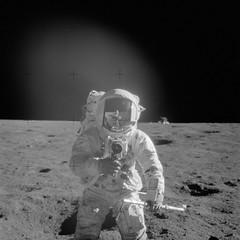 Apollo 12 Mission image - Astronaut Charles Conrad Jr., Apollo 12 commander, using a 70mm handheld Haselblad camera